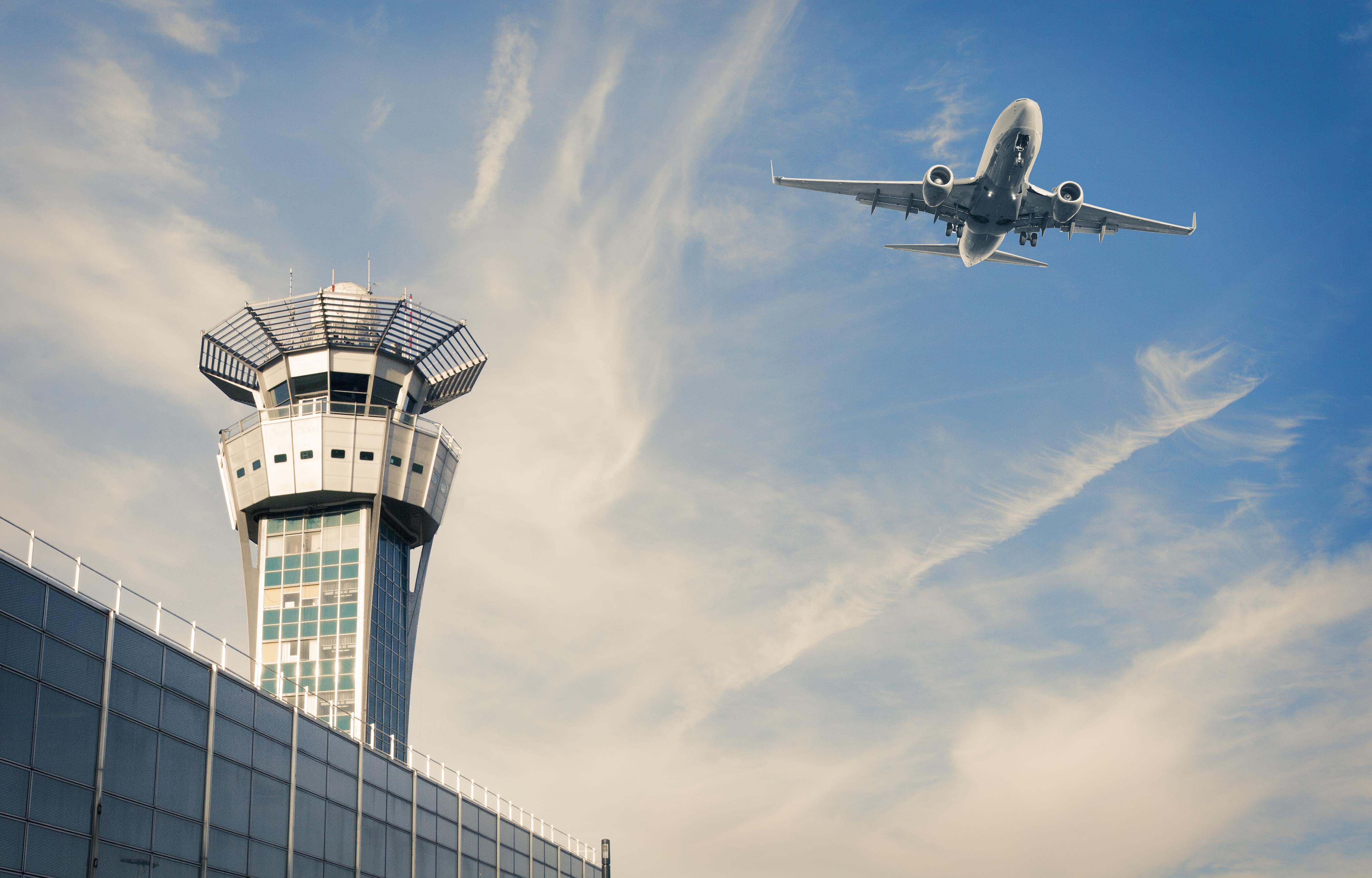 Air Trafic Control tower and airplance at Paris Airport